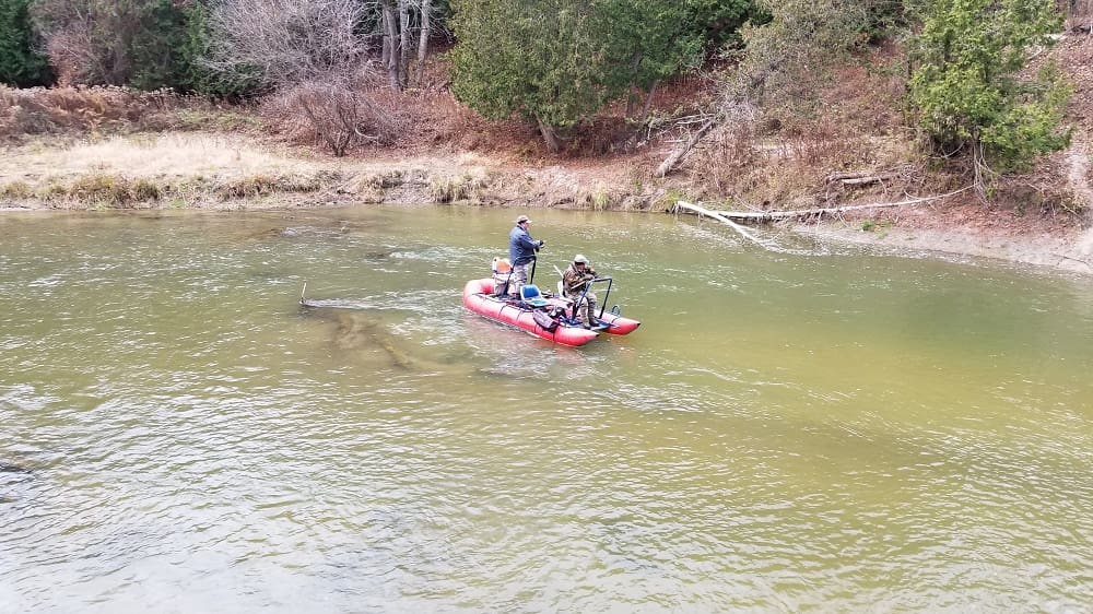 Anglers fishing on a medium size steelhead river