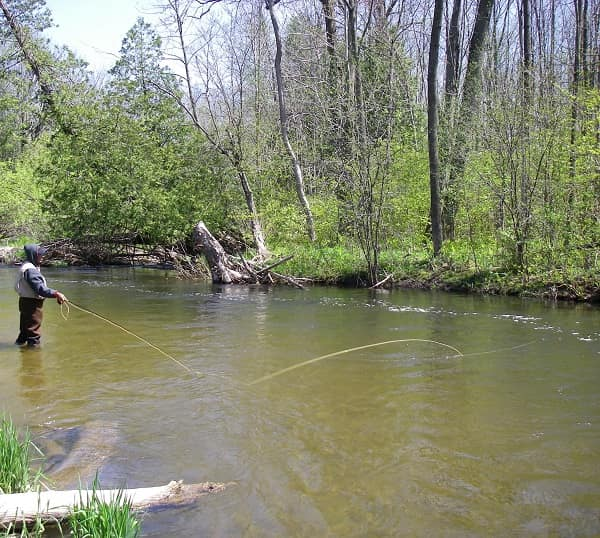 An angler using a typical flip mend.