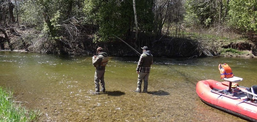 Anglers fishing on a small river with Centerpin reels
