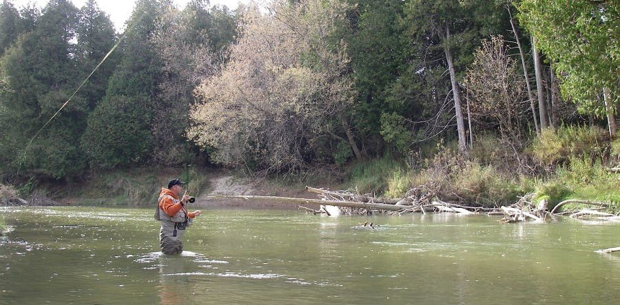 An angler standing in the wader in a good pair of steelhead waders