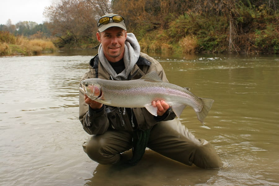 A river guide wearing a pair of the best waders for steelhead fishing