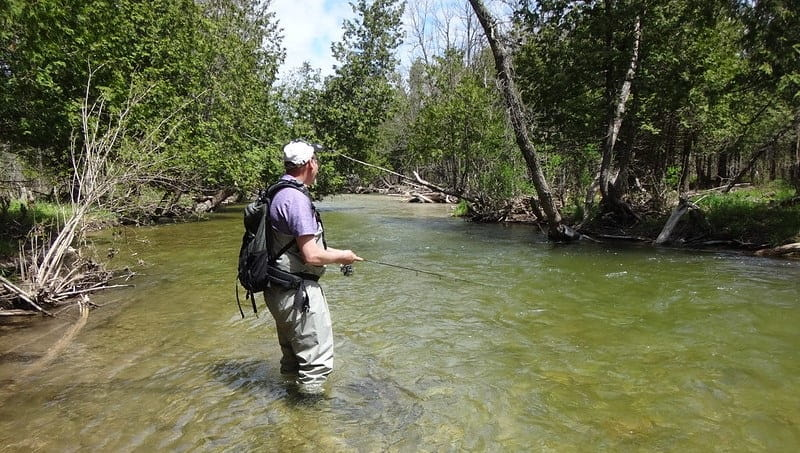 An angler using the right gear for float fishing for trout